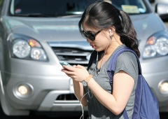 Girl engrossed on her mobile listening to music