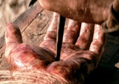 Nail being driven into Jesus' hand