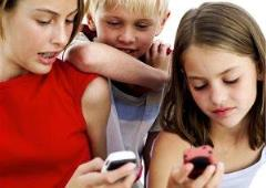 Children engrossed in mobile phones