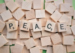 TThe word Peace spelled out using Scrabble tiles