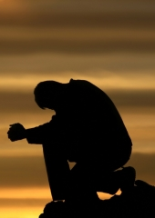 Man praying alone