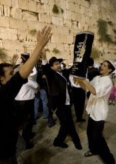 Jews dancing with the Torah Scroll