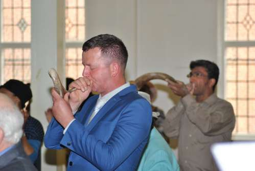 Blowing the shofar to open the feast