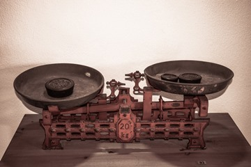A pair of old scales with weights in